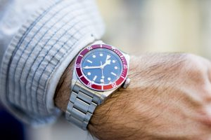 Wristwatch on a male model's hand showing time